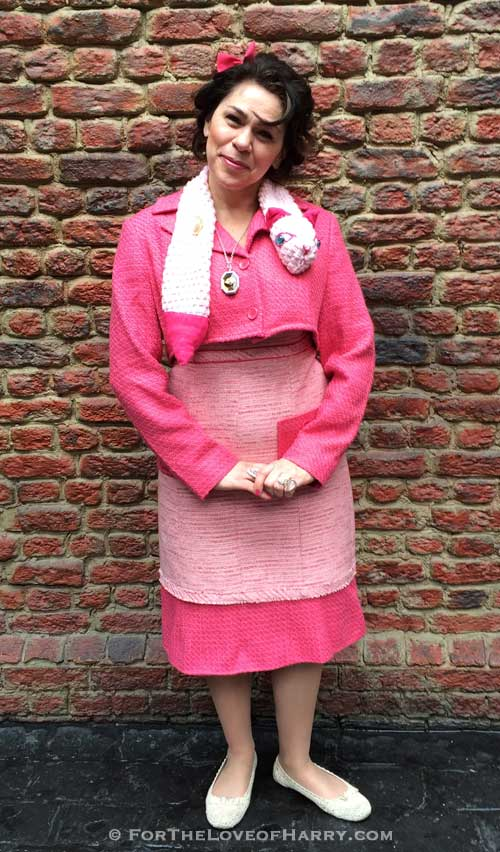 A woman dressed up as Dolores Umbridge