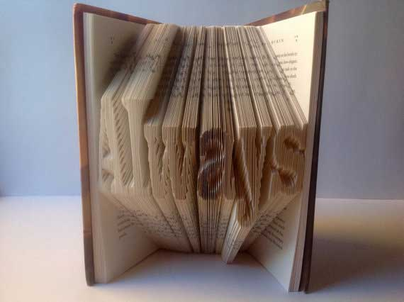 Harry Potter book with 'Always' etched into the pages