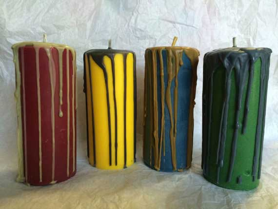 Drip candles in the colors of the four Hogwarts houses