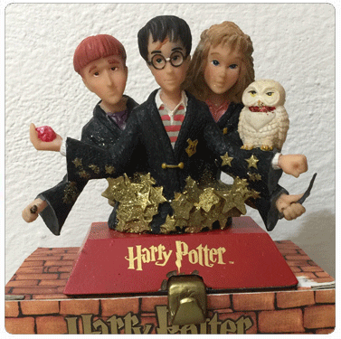 Stocking Holder made by Kurt Adler with Harry Potter, Ron Weasley, and Hermione Granger.