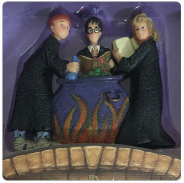 Kurt Adler resin Christmas ornament of Harry Potter, Hermione Granger, and Ron Weasley working on a potions assignment around a cauldron.